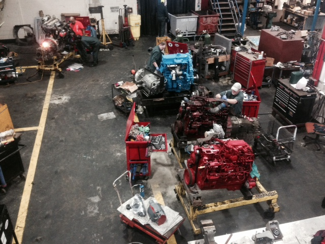 MBTA Machinists at Everett Bus repair work on bus engines.