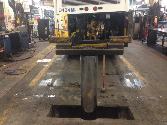 In ground bus hoist safety rail is broken and needs repair