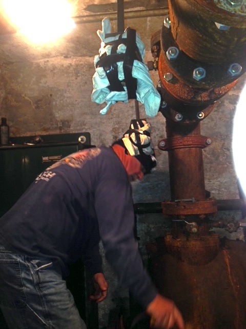 MBTA Outside Machinist & 264 President Jim Mastandrea works on a pump inside the tunnel system.