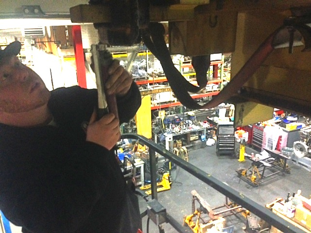 MBTA Outside Machinist Bob Walker doing maintenance on an overhead crane.