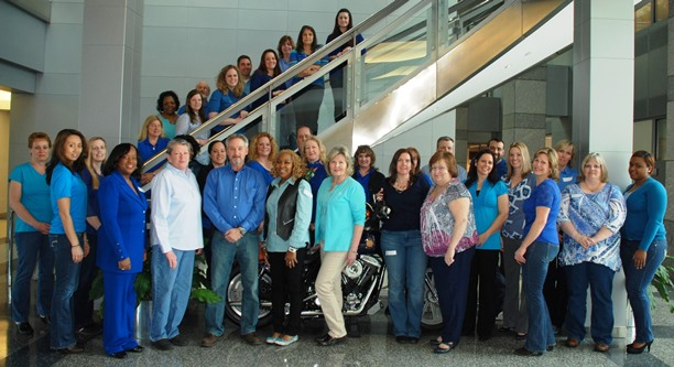 IAM staff wore blue shirts and jeans on April 2 to kick off Autism Awareness Month.