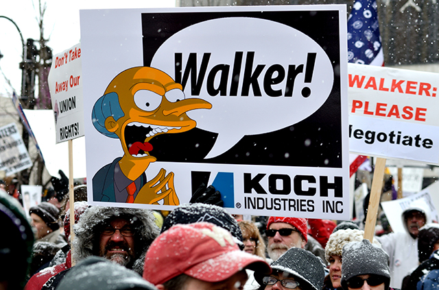 "Protesters in Madison, Wisconsin during a rally against Gov. Scott Walker's budget bill on February 26, 2011. Walker's recent support of regressive ""Right-to-Work"" legislation has laid the groundwork for other states to follow in his footsteps. (Photo: AAraujo / Shutterstock.com)"