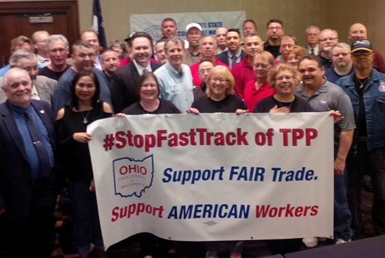 The Ohio State Council of Machinists and U.S. Sen. Sherrod Brown (D-OH), center in light blue shirt, joined many others in the labor, human rights and environmental communities to come out against Fast Track for the Trans-Pacific Partnership.