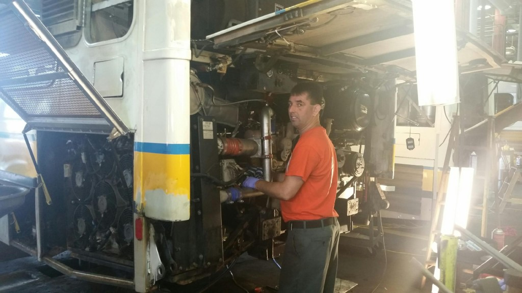 Kevin Broburge prepping the bus for a power plant installation.