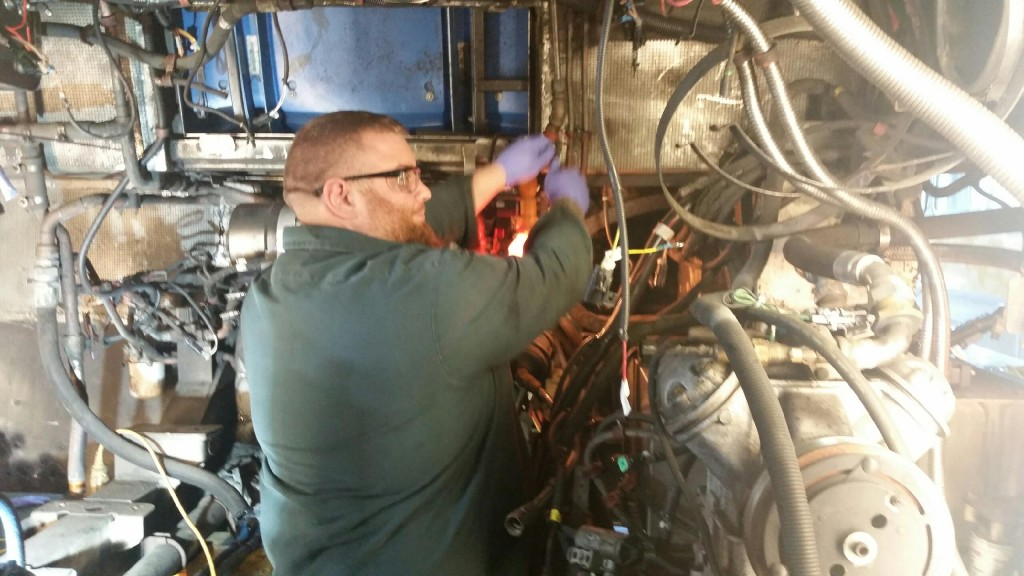 Pete O'melia working on some repairs at Everett bus.