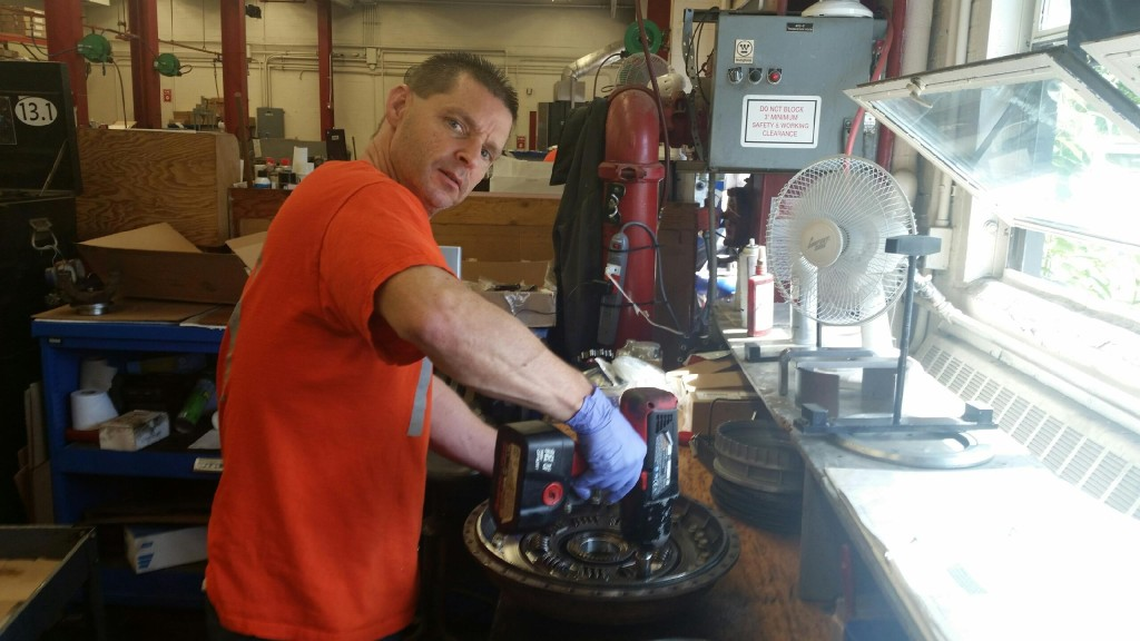 Charlie Long  working in the transmission dept at Everett Bus.