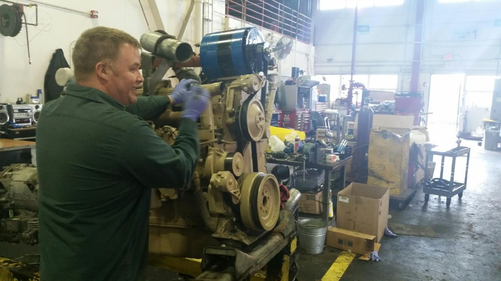 Chad Barrett putting the finishing touches on a rebuilt engine.