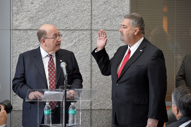 Former IAM International President Tom Buffenbarger, left, administers the oath of office to new International President Bob Martinez, Jr. (Photo by Bill Burke / Page One Photography)