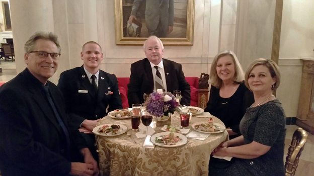 Norb Balinski, center, and his wife, Gloria, second from right, dine at the White House with other invitees to President Obama's State of the Union address
